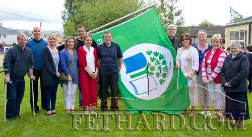 Photographed at the raising of the first Green Flag at Holy Trinity National School are L to R: Brian Sheehy (Tidy Towns), Fr. Anthony McSweeney, Ann-Marie Harty, Rita Kenny, Willie Ryan, Margaret Gleeson, Joe Keane (Tidy Towns), Canon Tom Breen P.P., Mary Carroll (Environmental Officer), Maureen Maher, Patricia Treacy (Principal) and Sr. Maureen Power.