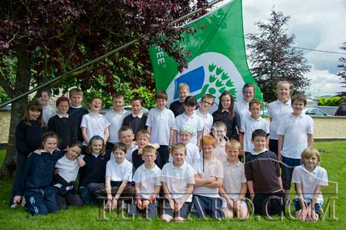 Pupils photographed at the raising of the first Green Flag at Holy Trinity National School Fethard