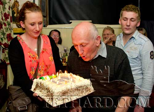 Frank blowing out the cake candles