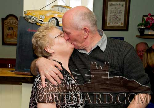 A birthday kiss for Frank from friend, Kathleen Connolly