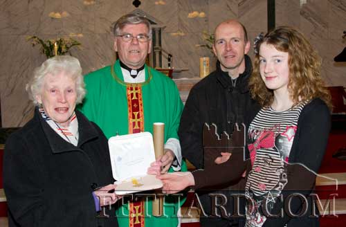 Canon Tom Breen P.P. making a special presentation  of a Papal Medal 'Benemerenti' to organist, Goldie Newport, marking over 100 years service as church organist to Fethard Parish between herself and her late mother, Ciss Newport. L to R: Goldie Newport, Canon Tom Breen P.P., Fr. Anthony McSweeney C.C. and Aisling Gorey who also made a presentation on behalf of this year's Confirmation Class.