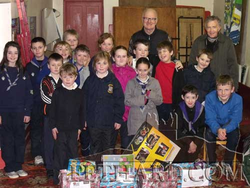 27th Tipperary Cub Scouts handing over their gifts to Vincent Doocey and Denis Burke from Fethard St. Vincent de Paul, as part of their 'Acts of Kindness' project. The Cubs gave up their pocket money to help ensure that all kids get a gift this year for Christmas.