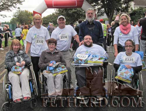 Photographed after completing the Cork Mini Marathon last weekend for the Irish Wheelchair Association are back L to R: Kathleen Burke, John Ryan, Joe Kenny, Helen Carrigan. Front L to R: Jenny Burke, Mary Walsh, Jack Kenny and Lorraine Doherty.
