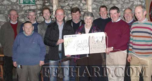 Members of Coolmoyne/ Moyglass Vintage Club presenting a cheque to the 'End of Life Care Committee' at South Tipperary General Hospital. L to R: Pat Kennedy, Henry Smyth, Joe Walsh, John Slattery, Richard Cummins, M.G. Ryan, Ann Guiry, Michael Horan, Sean Donovan, Michael Fahy and Seamus Barry.