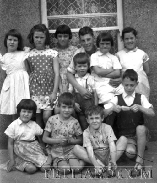 Children on The Green in the 1960s. One of the many photographs on display at The Green & Barrack Street Reunion on Saturday 18th August. Back L to R: Marion McCormack, Una Sharpe, Margaret McCarthy, Tommy McCormack (front), Don McCarthy, Theresa McCarthy, Marian McCarthy. Front L to R: Valerie McCormack, Michael McCormack, Martin Healy and Michael McCarthy.