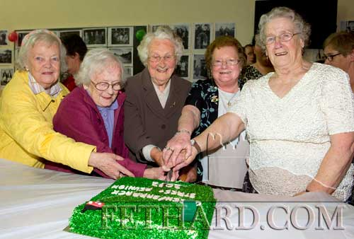 The honour of cutting the cake at The Green and Barrack Street Reunion fell to L to R: Kathleen Kenny, Mary Newport, Aggie Barrett, Kitty O'Donnell and Esther McCormack