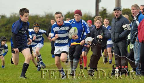 With cheers and support from everyone on the sideline, Barry McGrath makes a break for Fethard during their Under 13 match against Waterford City on Sunday, October 7. Fethard went on to win the game 34-0.