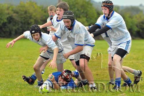Six of the Fethard Under 15 players - Pierce Blackmore, Gary Kavanagh, Tim Daly, Bill Phelan, Andrew Phelan and John Clancy - are intent on stealing possession from the isolated Dungarvan player when the teams met on Sunday, October 7, in the Community Sportsfield.
