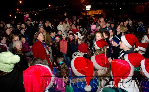 Large group of children who turned up to sing Carols as they waited for Santa to switch on the Christmas lights at Fethard's 'Festive Friday' on December 7.