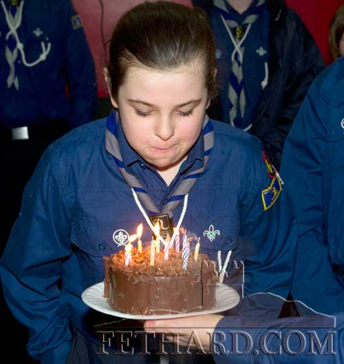 Billie Jean O'Shea celebrating her 12th birthday as she blows out the candles on a surprise birthday cake presented to her at Fethard Scouting 25th Anniversary celebrations in Fethard Ballroom.