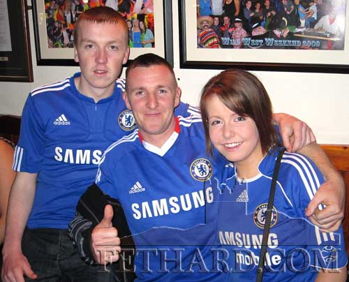 Chelsea supporters celebrating in Fethard last weekend after their team took one step closer to winning the title. L to R: Adam Lyons, Ronan Allen and Amy Lyons.