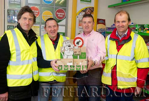 Fethard Tidy Towns members photographed at the launch of their free 'Poop Scoops', now made available at Fethard Post Office, in conjunction with South Tipperary County Council. L to R: Nick Casey, Joe Keane, Barry Connolly (Fethard Post Office) and Jimmy Horan (Area Foreman with South Tipperary County Council).