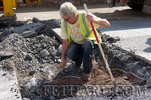 Archaeologist Jim Crane supervising dig at Pierce's Gate, Barrack Street, to determine where the medieval town wall crossed the road.