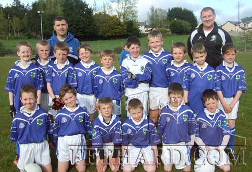 Fethard U10 mixed football team who competed in the Community Games South semi-final. Back L to R: coaches Eugene Walsh and Michael O'Mahony. Middle L to R: Keenan Ahearne, Ryan Walsh, Cathal Ryan, Robert Wall, Michael Quinlan, Josh Nevin, Matthew Burke, Shane Neville, David Cowlard,  Nell Spillane. Front L to R: Shane Neville, Michael Cuddihy, Thomas Donegan, Toby Collier, Sean Moroney and Kieran O'Donnell.