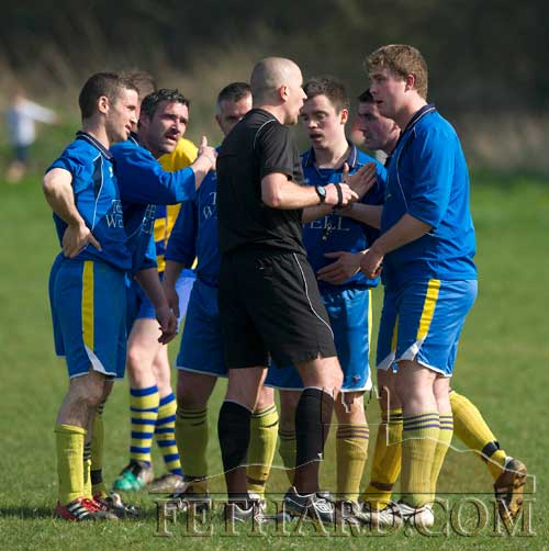Referee Johnny Walsh keeping the peace with Killusty players