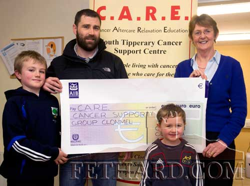 Eugene Walsh presenting a cheque for €2,000, proceeds of his run in the Dublin City Marathon and a fundraising evening at The Castle Inn Fethard, to Eileen McEvoy, Administrator CARE (Cancer Aftercare Relaxation Education) Centre in Clonmel. Eugene would like to thank all those who supported his fundraising by buying tickets and giving sponsorship. Also included in the photograph are Eugene's two sons, Ryan (left) and Charlie.