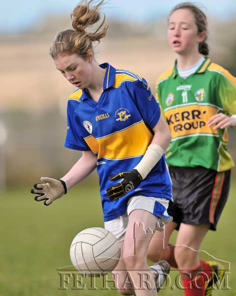 Molly O'Meara retains possession in the Kerry v Tipperary Under 13 Inter-County match on Saturday, November 17.