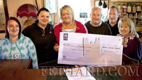 Community Jackpot Winner. L to R: Tracy Needham, Roseanne Needham, Samantha O'Brien (joint jackpot winner with Mikey Fitzgerald who was unavailable for photograph), Tom Purcell (jackpot ticket seller), John Carroll (LOnergan's Bar) and Joan O'Donohoe (Fethard & Killusty Community Lotto).