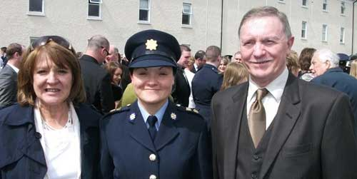 John Mullins, originally from Woodbine Cottage, Abbey Street, Fethard, is photographed with his wife Anne and daughter Áine at her passing-out parade at the Garda College Templemore. John served 37 years in the Gardai and retired in 2001. He now lives in Bunclody, Co. Wexford, and his daughter is based in Tramore.