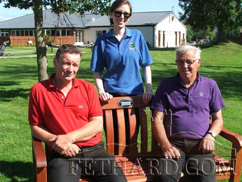 Michael O'Meara, Louise Lalor and Billy Phelan photographed at the new memorial seat on the 1st tee at Slievenamon Golf Club. The Phelan family donated the seat to the club on the 10th anniversary of Billy's sons, John and David, who tragically died shortly after 8pm on Sunday, August 4, 2002, following a road accident at Market Hill.