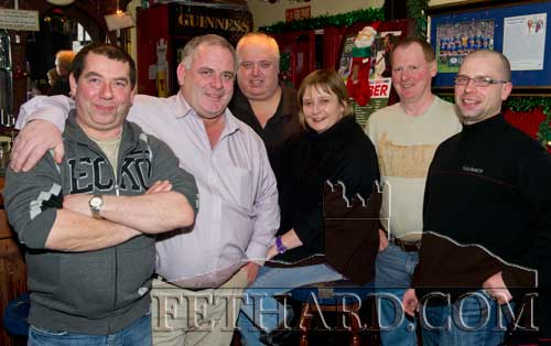 Enjoying a drink in Butler's Bar over Christmas were L to R: Colm Hackett, Matt O'Dwyer, Davy Maher, Gretta O'Dwyer, Willie O'Donnell and Luke Hackett.
