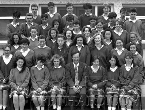 Fethard Patrician Presentation Leaving Certificate Class 1993, Back L to R: Larry Hayes, Martin Griffin, Tom Neville, Richard Hayes, Patrick Walsh, Oliver Maher. 4th Row: James Noonan, Oliver Woodlock, James O'Donnell, Karen Kenny, John Paul Keane, Martha Fahy, John Walsh, Christine Fanning, Barry Boland, Elizabeth Burke, Fergal Corbett. 3rd Row: Hazel Hickey, Marie Cloonan, Marie Meaney, Anne Morrissey, Patricia Purcell, Mia Treacy, Caroline Wilson. 2nd Row: Teresa Sayers, Catherine O'Donnell, Martha Williams, Niamh Ryan, Rita Hickey, Serena Lawless, Denise Gleeson, Lorraine Treacy. Front Row: Kathleen Nevin, Sarah Coen, Lorraine Carroll, Mr Ernan Britton (School Principal), Edel Fogarty, Denise Wallace and Carmel Allen.