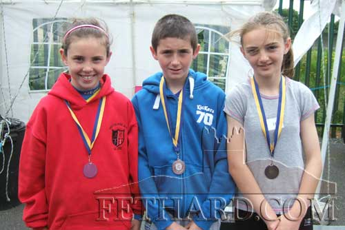 L to R: Leah Coen, Ben Coen and Alison Connolly all won silver medals at the Community Games County Athletic Finals in Templemore