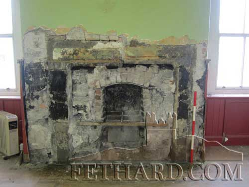 Fireplace in the centre of the front wall of the almshouse.