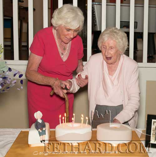 Mary (Casey) Canty helping her mother Josie (Holohan) Casey cut the cake at her 100th Birthday Party celebrated at Fethard Convent Community Hall