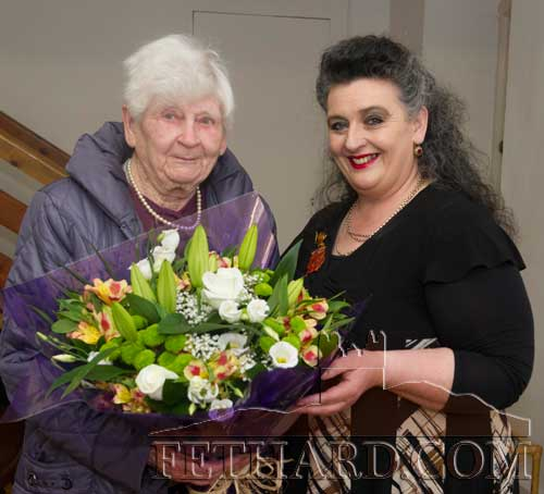 Kitty Delany presented with a bouquet of flowers from chairperson, Pat Looby (right), after being conferred a life member of Fethard Historical Society at the society's 25th annual general meeting held in the Abymill Theatre on April 30, 2013.
