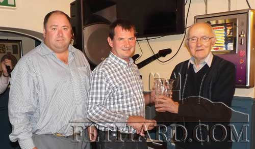 Michael Ryan (center) receiving the July Fethard Sports Achioevement Award from special guest, Tony Newport. Also included is Liam Downey (left) representing this month's sponsor, J&C Kenny, Wine and Spirit Wholesalers, Galway.
