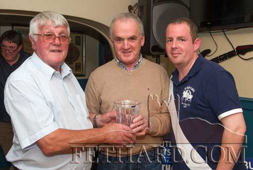 Special guest, Sean Moloney (left), presenting the Butler's Bar Fethard Sports Achievement Award for August to M.C. Maher who accepted the award on behalf of his son Cian Maher who is presently working in New York. Also included is Mark Cummins (right) representing this month's sponsor Gleeson Wines.