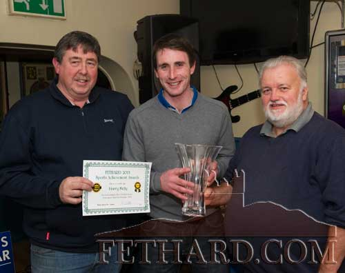 Harry Kelly (centre) receiving his Fethard Sports Achievement Award for November from special guest, Brendan Kenny (right). Also included is Philip Butler, proprietor Butlers Sports Bar.