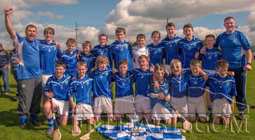 County ChampionsEugene Walsh and Mick O'Mahony celebrate with the Fethard U14 team following their victory over Solohead in the U14C County Final on Saturday, September 14.