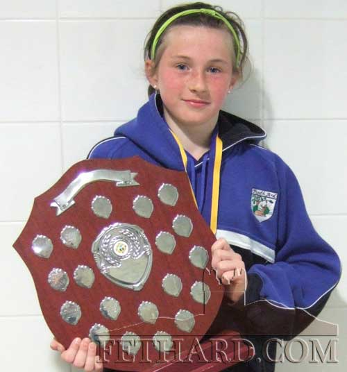 Lucy Spillane, Captain of Fethard girls football team, proudly displaying the County Community Games Trophy.