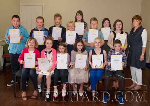 Successful students in the recent Irish Board of Speech & Drama awards ceremony for grade examinations in Verse Speaking and Communication Skills photographed at the Tirry Community Centre Fethard. Back L to R: Ciarán O'Leary, Emma Moore Kelly, Adam Buttimer, Paddy Fitzgerald, Elizabeth Kennedy, Sam Quigley, Louise Prendergast, Aisling Prendergast, Nancy Farrell (Instructor). Front L to R: Carol Ann Ryan, Anna Quigley, Anna Collier, Sorcha O'Brien (Gold Medal Winner), Katie Ryan and Seamus O'Brien. Missing from photo were Aoibhinn Brennan, Beth Buttimer, Henry Buttimer, Amy Kirby and Jack Sheehy.