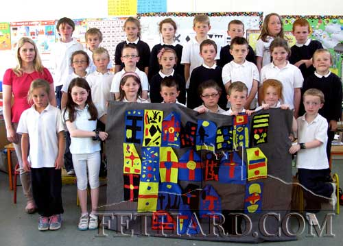 1stt Class Pupils at Holy Trinity National School preparing their banner for this year's Medieval Festival parade that will take place on Sunday, June 23, in conjunction with the Fethard Gathering Festival the same weekend.