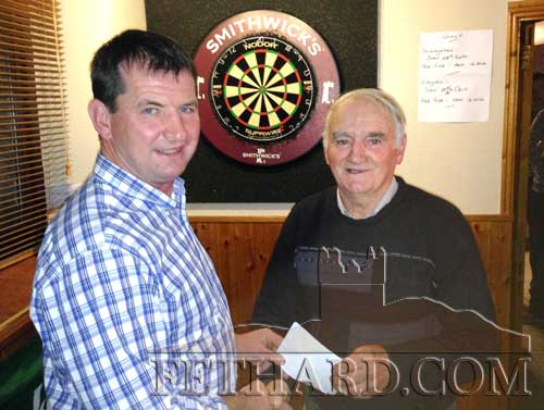 Michael Ryan, Tipperary Intermediate winning manager, receiving a GAA club presentation from Jimmy O'Shea (right) at Burke's Bridge Bar.
