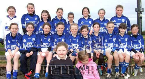 U12 girls Community Games GAA team. Back L to R: Rachel Prout, Ava Hickey, Ava Ward, Sophie Delaney, Ellie Davaney, Emma Geoghan, Lucy Spillane, Caoimhe O'Meara. Front L to R: Ciara Connolly, Emma Lyons, Hannah Dolan, Leah Coen, Carrie Davey, Aine Ryan, Laura Harrington, Alison Connolly, Aoife Morrissey, Nell Spillane. Kneeling in front are mascots Zoe Prout and Emily Spillane.