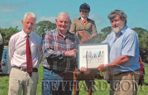 Noel Byrne (right), Chairman Killusty Pony Show, making a presentation to Jim Williams to mark his 50 plus years service and loyalty to Killusty Pony Show. Also included is show secretary, Pat Culligan (left).