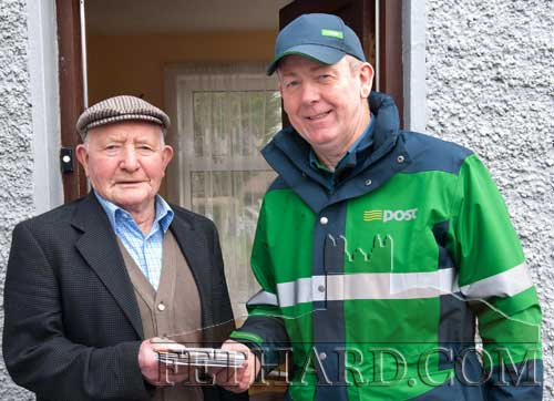 Local postman John Fogarty, photographed delivering birthday wishes to the late Jimmy Walsh, Kilconnell, Fethard, on the occasion of his 90th birthday