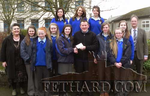 Pictured above is Mr Joe Keane, Chairman Fethard Tidy Towns, presenting a cheque towards sponsoring pupils who will travel as supporters of the local Junk Kouture entry in UL on Thursday. Also included in the photograph with the pupils are Ms Pat Looby (Art Teacher) and Mr Ernan Britton (School Principal).