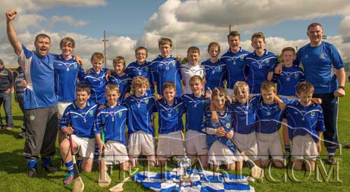 Eugene Walsh and Mick O'Mahony celebrate with the Fethard U14 team following their victory over Solohead in the U14C County Final on Saturday, September 14.