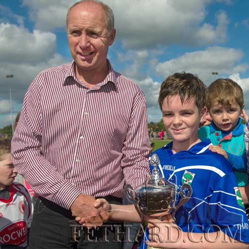 Jesse McCormack, captain of the Fethard U14 team is presented with the cup following his team's victory over Solohead in the U14C County Final on Saturday, September 14.