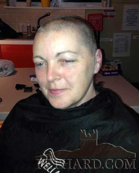 Lizzie Reddy after having he head shaved for Cancer Research
