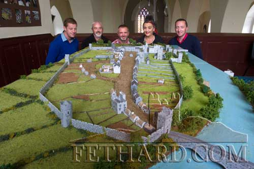 Helping to move the Medieval Fethard 3D Model from Holy Trinity Church of Ireland to the County Museum are L to R: John Cummins, Connie Sullivan, David Kirwan (Artisan Frames), Pat Looby and Justin McGree.