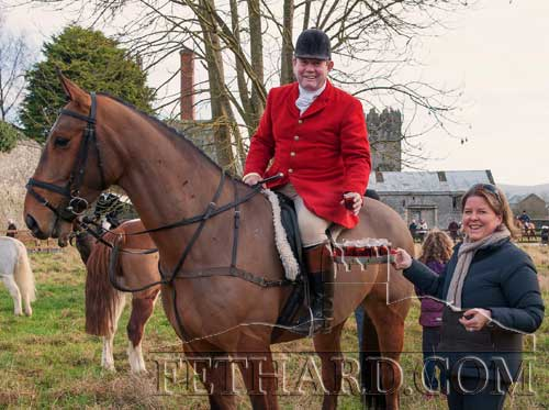 Paul Ronan having some refreshments from Frances Boyle at the Tipperary Foxhounds New Year's Meet in Fethard.