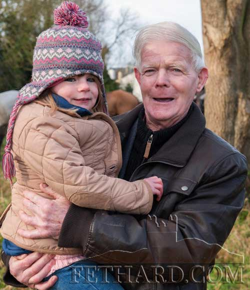 Long time Fethard hunt supporter, Mickey Fitzgerad, holding Lauren Donegan at the New Year's Meet in Fethard.