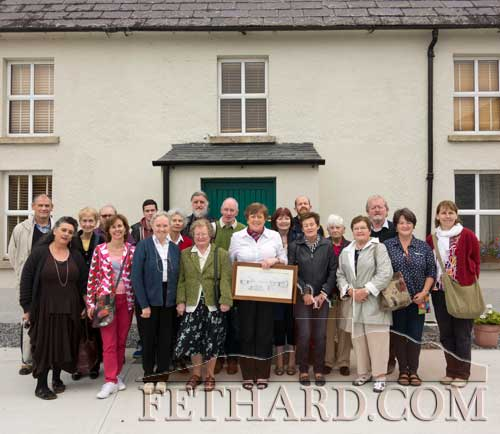 Group photographed outside the J.F. Kennedy Homestead in Dunganstown while on the Fethard Historical's 25th Anniversary trip to Wexford