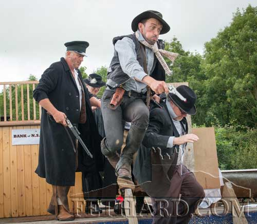 Conor O'Donnell playing his active role in the Bank Robbery re-enaction at the Ned Kelly Festival in Moyglass